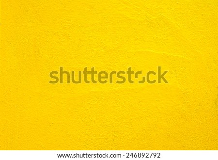 Concrete wall yellow color for texture background - stock photo