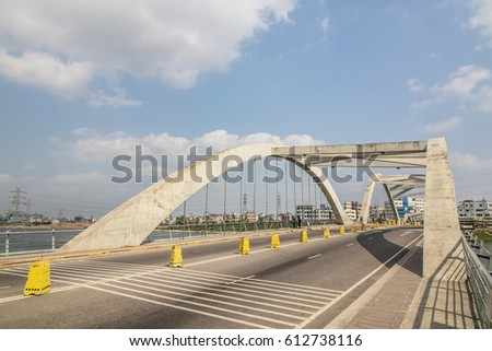 concrete wave bridge on lake