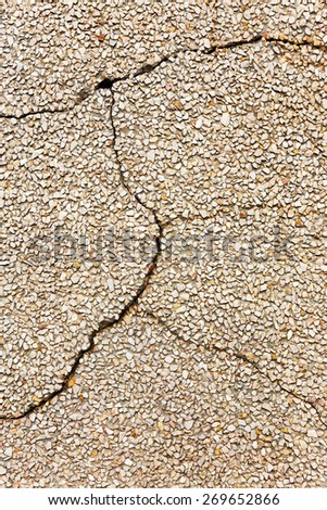 Concrete with small stones, cracks and scratches, weathered, worn. Grungy Concrete Surface. Great background or texture. - stock photo