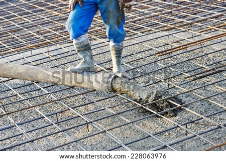 concrete work, pouring cement mortar into formwork - stock photo
