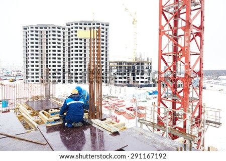 concrete work: workers carpenters preparing construction formwork for concreting at building area  - stock photo