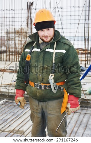 concrete worker. positive foreman in front of concrete reinforcement during construction formwork for concreting at building area  - stock photo