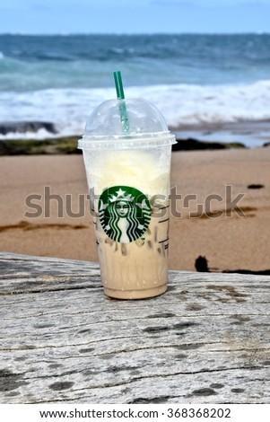 CONDADO, PUERTO RICO - JANUARY 25, 2016: A Starbucks coffee on the beach in Condado, Puerto Rico. Starbucks Corporation is an American coffee company and coffeehouse chain. - stock photo