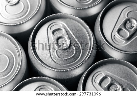 Condensation on the top of cans of drinks - stock photo