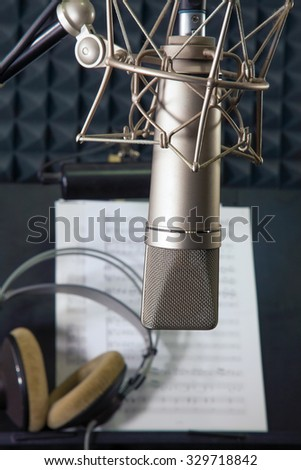 Condenser microphone prepared for singer in vocal recording room  - stock photo