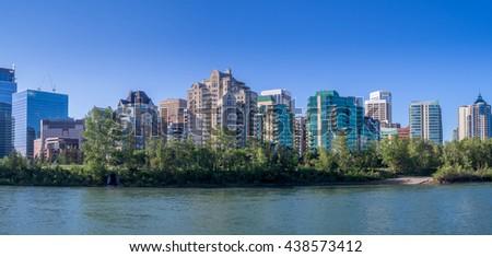 Condo towers in urban Calgary along the Bow River - stock photo