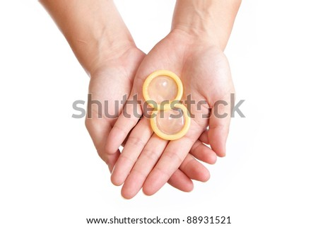 condom and hand isolated on white background - stock photo