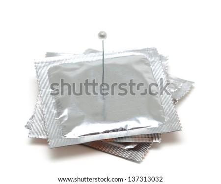 condom and needle isolated on white background