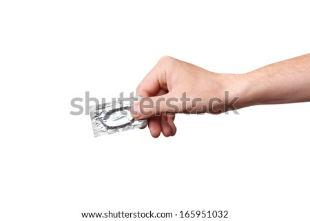 Condom in hand, isolated on white background - stock photo