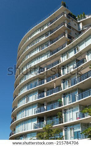 Condominium or apartment building with curved roof in the city downtown. - stock photo