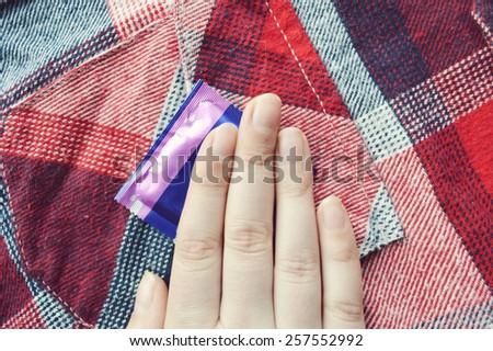 condoms, cosmetics, women's beautician, protection - stock photo