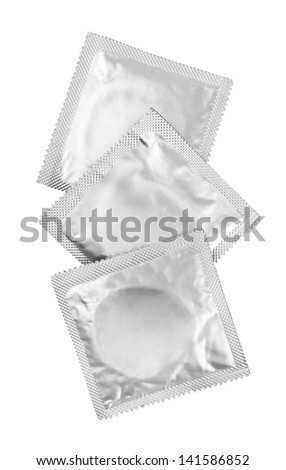 Condoms isolated on white background - stock photo