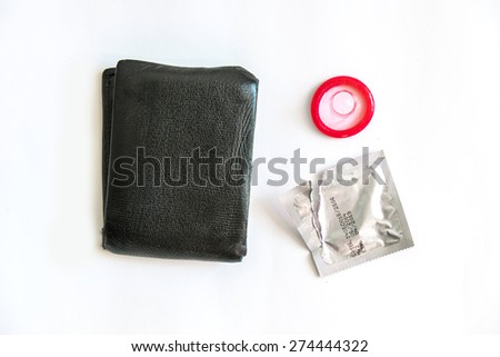 Condoms with wallet on white background , save sex - stock photo