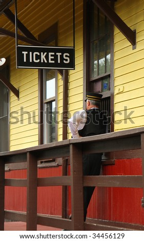 Conductor waiting for train on railroad station