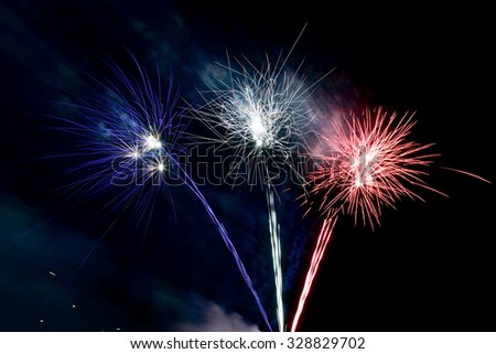 Coney Island Fireworks on the beach on a summer evening in Brooklyn, New York. - stock photo