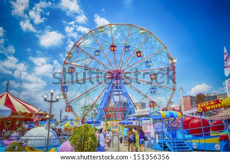 CONEY ISLAND - MAY 30: The famous Wonder Wheel in Coney Island, May 30, 2013. The Eccentric Ferris Wheel was built in 1920, it has 24 fully enclosed cars,giving a total capacity of 144 passengers   - stock photo