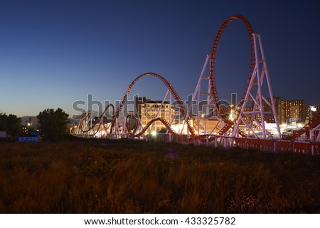 Coney Island roller coaster at night.  - stock photo