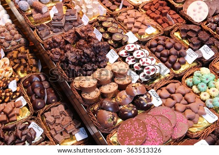 Confectionery at Boqueria market place in Barcelona, Spain. Assorted chocolate candy shop. - stock photo