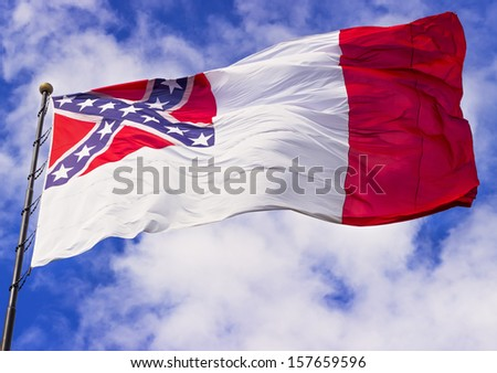 Confederate flag flying in the wind  - stock photo