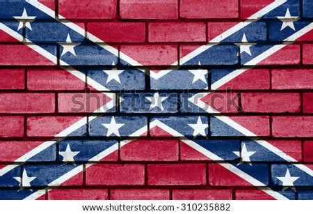 Confederate flag painted on old brick wall texture background - stock photo