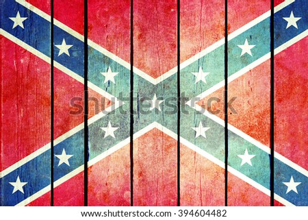 Confederate wooden grunge flag. Flag of the confederacy painted on the old wooden planks. Vintage retro picture from my collection of flags.