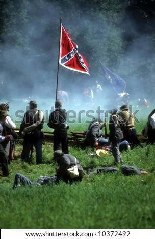 Confederates defend the flag,Civil War battle reenactment - stock photo