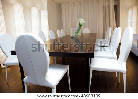 conference hall with white chairs