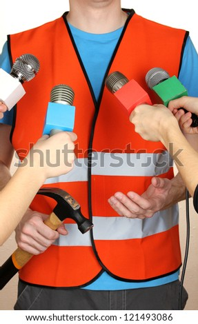 Conference meeting microphones and road worker - stock photo