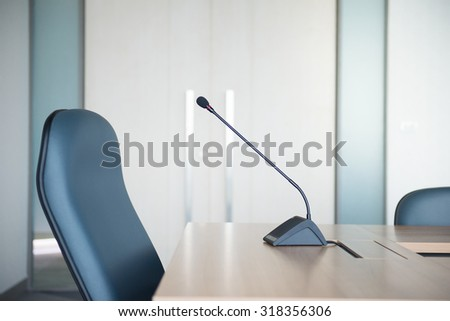 Conference Microphone in the meeting room (Selective Focus) - stock photo