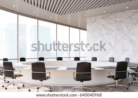 conference room interior with a round table black office chairs near it a marble