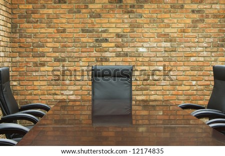 conference room with brick wall - stock photo
