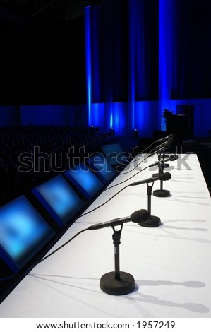 conference room with microphones on the table - stock photo