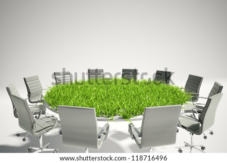 Conference table covered with grass - business outlook concept - stock photo