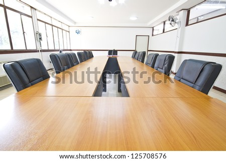 Conference table in conference room - stock photo