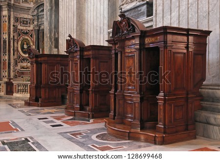 Confession booth in St. Peter Cathedral in Vatican