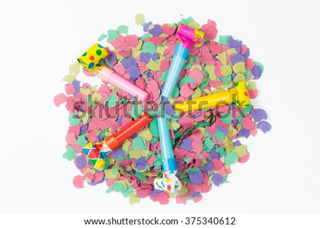 confetti and party blower on white background - stock photo