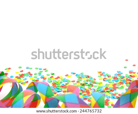Confetti and party streamer on white background - stock photo
