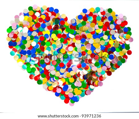 confetti in heart shape. colorful shiny background