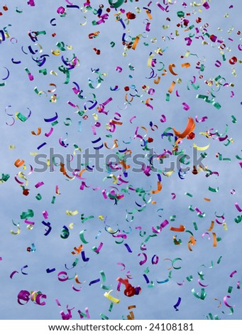 Confetti on the air against blue sky - stock photo