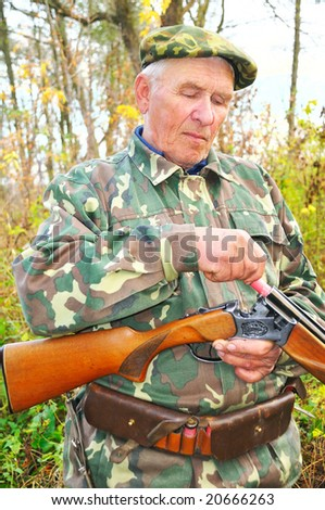 confidence hunter load rifle on background autumn