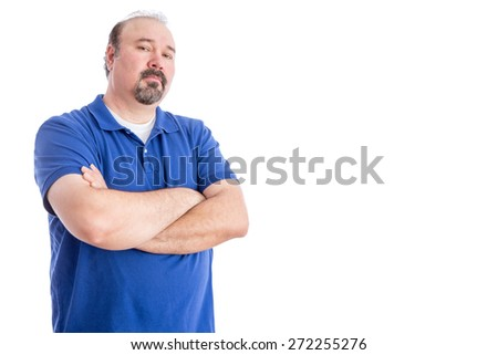 Confident Adult Man in Blue Shirt, Crossing his Arms Over his Stomach and Looking at the Camera Aggressively. Isolated on White Background with Copy Space on Right. - stock photo