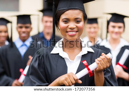 confident african american female university graduate holding diploma - stock photo