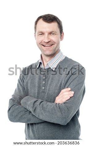 Confident aged man posing with folded arms - stock photo