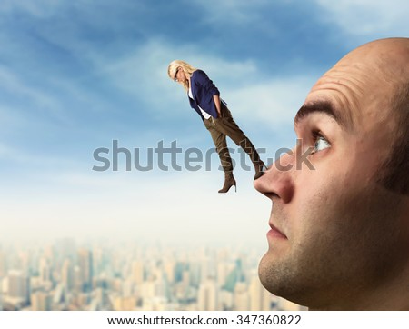 Confident analyst is walking on the man's face - stock photo