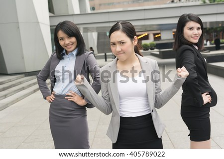 confident and successful business woman with her team - stock photo