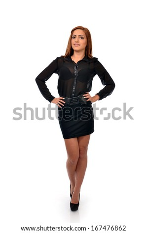 Confident arab business woman with hands on waist in full lenght pose over white background