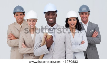 Confident architectural team smiling at the camera - stock photo