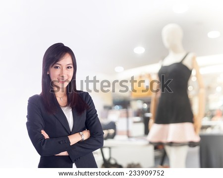 Confident Asian business woman - stock photo