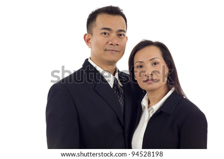 Confident Asian couple isolated over white background - stock photo