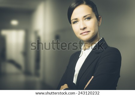 Confident attractive business woman with arms crossed  - stock photo